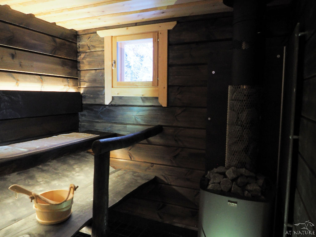 Benches and stove of Traditional Sauna of AT NATURE.