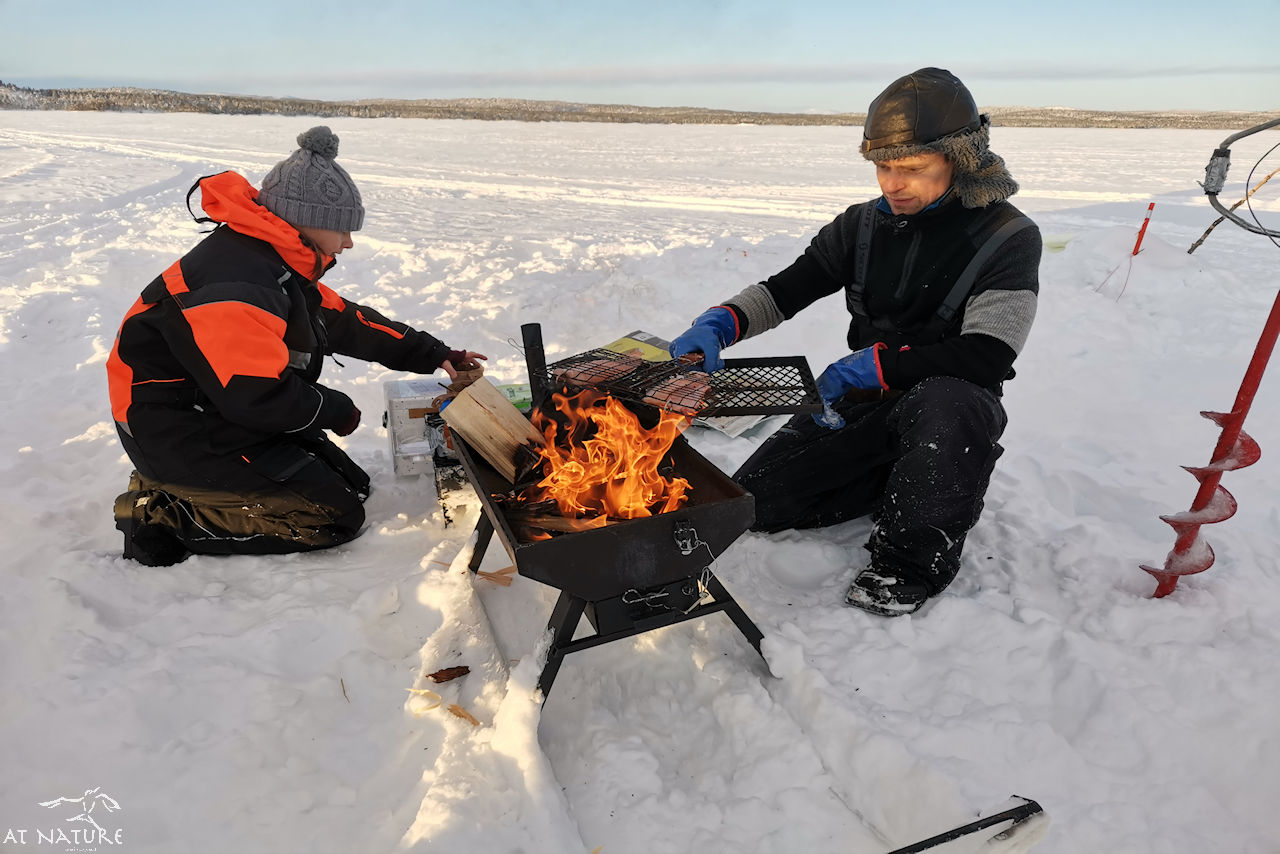 AT Nature Terhi and Arto are making a open-fire lunch.
