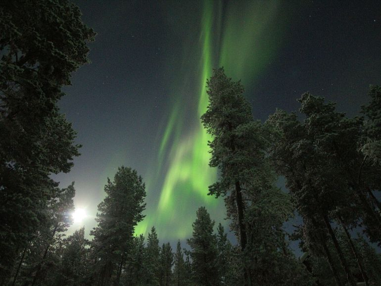 Northern lights and the Moon in the sky.