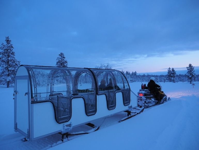 AT Nature glass roof sleigh in a wilderness.